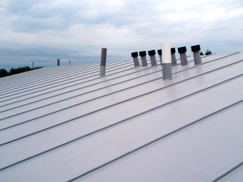 Single Ply Membrane : Thermoplastic roof restored using silicone coating